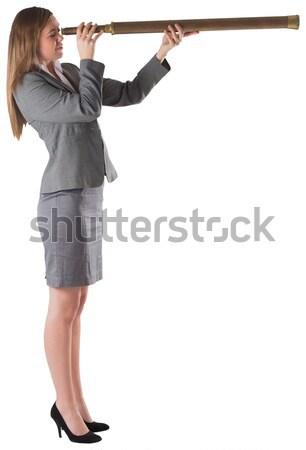 Kobieta interesu patrząc teleskop biały garnitur korporacyjnych Zdjęcia stock © wavebreak_media