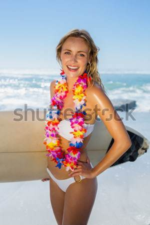 Beautiful smiling blonde with flower hair accessory on the beach Stock photo © wavebreak_media