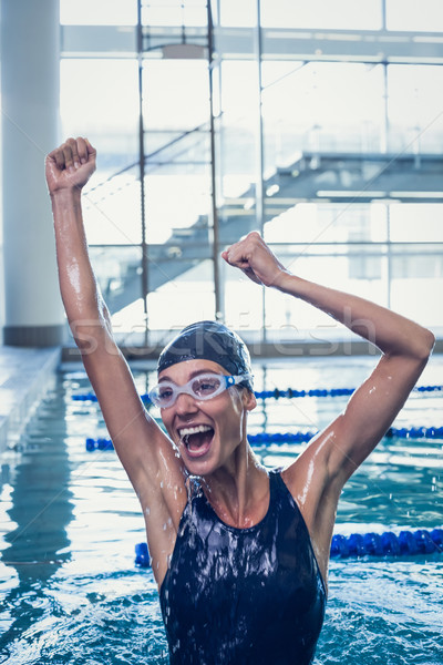 Excited swimmer jumping up the swimming pool Stock photo © wavebreak_media