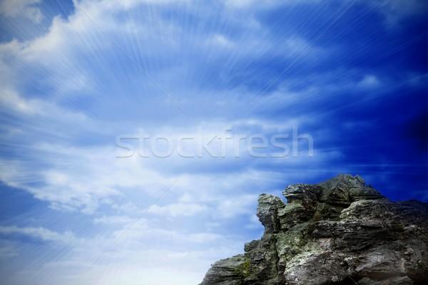 Large rock overlooking bright blue sky Stock photo © wavebreak_media