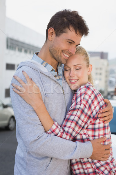Hip young couple hugging in the road Stock photo © wavebreak_media