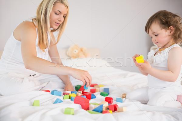 матери дочь играет блоки кровать вид сбоку Сток-фото © wavebreak_media