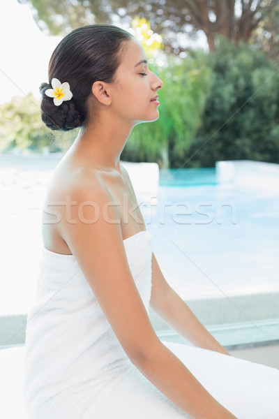 Beautiful woman sitting with eyes closed at spa center Stock photo © wavebreak_media