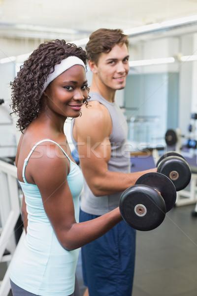 Uygun çift dambıl birlikte spor salonu Stok fotoğraf © wavebreak_media