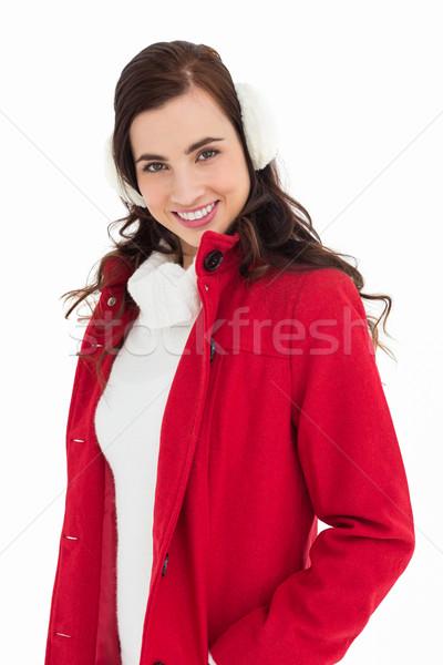 Smiling brunette posing with winter wear Stock photo © wavebreak_media