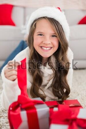 Smiling brunette holding many gifts Stock photo © wavebreak_media