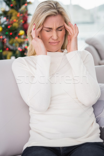 Blonde getting a headache on christmas day Stock photo © wavebreak_media