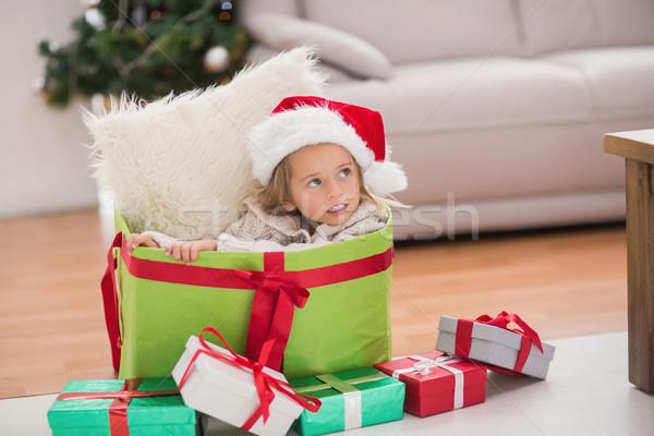 Sevimli küçük kız oturma dev Noel hediye Stok fotoğraf © wavebreak_media
