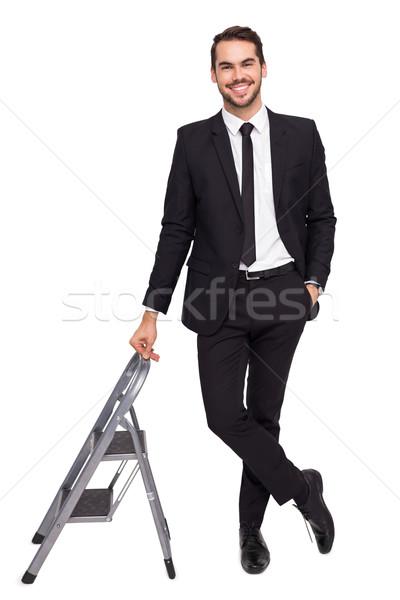 Mosolyog üzletember dől boldog öltöny fehér Stock fotó © wavebreak_media