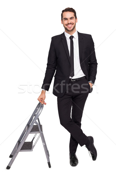 Smiling businessman leaning on stepladder Stock photo © wavebreak_media