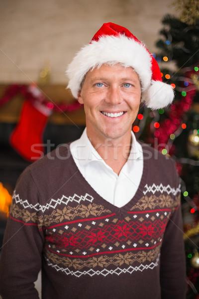 Portrait of a smiling handsome man in santa hat Stock photo © wavebreak_media