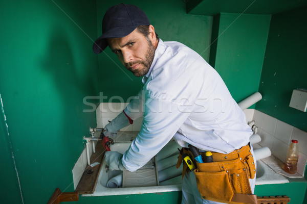 Construction worker frowning at camera  Stock photo © wavebreak_media