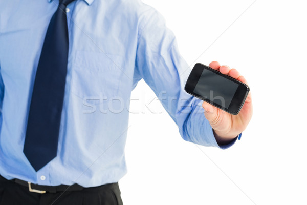 Close up of businessman holding a phone Stock photo © wavebreak_media