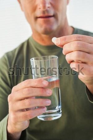 Középső rész férfi tart üveg víz tabletta Stock fotó © wavebreak_media