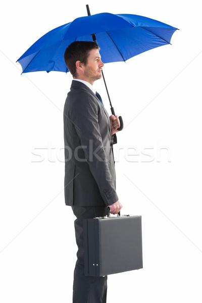 Grave empresario paraguas maletín blanco Foto stock © wavebreak_media