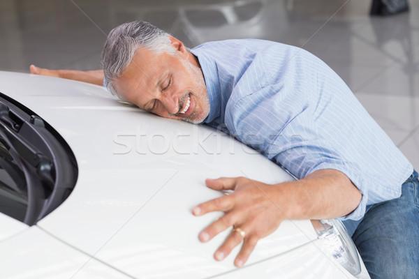 Smiling man hugging a white car Stock photo © wavebreak_media
