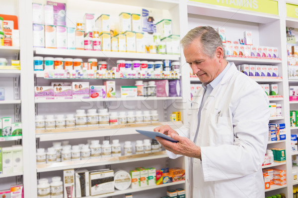 Senior pharmacist using tablet pc Stock photo © wavebreak_media
