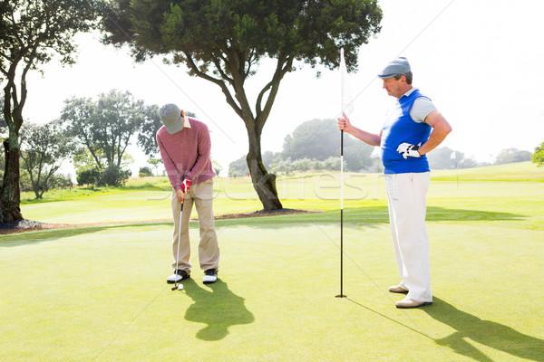 Jogador de golfe clube amigo campo de golfe homem esportes Foto stock © wavebreak_media