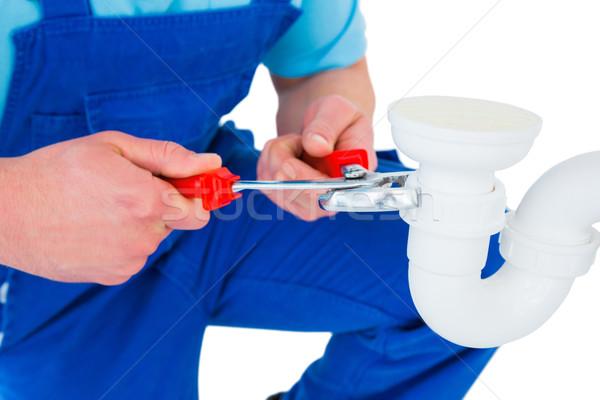 Handyman repairing sink pipe Stock photo © wavebreak_media