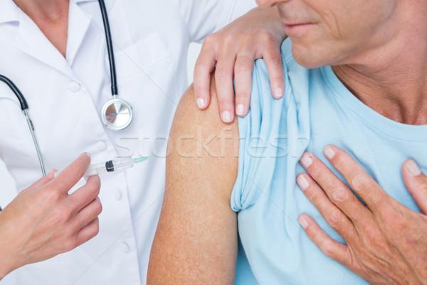врач инъекций пациент медицинской служба стороны Сток-фото © wavebreak_media