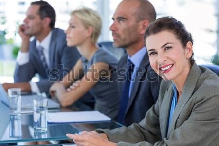 Człowiek biznesu uśmiechnięty kamery zespołu za kobieta Zdjęcia stock © wavebreak_media