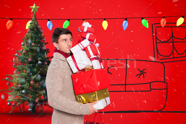 Stock photo: Composite image of young man with many christmas presents