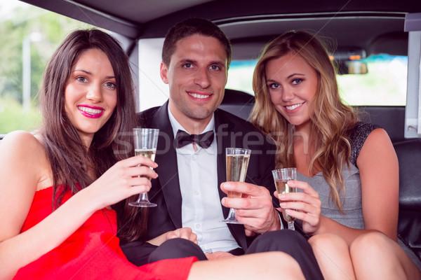 Boldog barátok iszik pezsgő limuzin bulizás Stock fotó © wavebreak_media