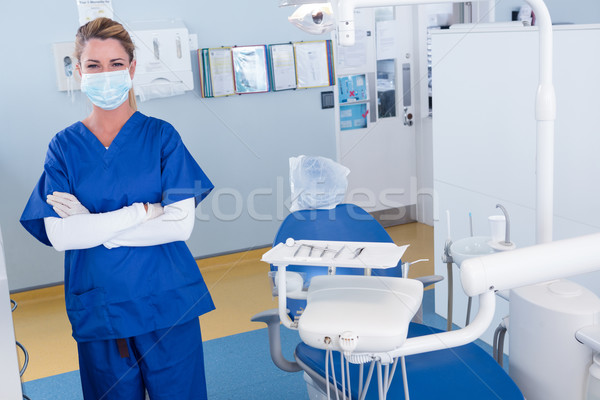 Dentist smiling at camera with arms crossed Stock photo © wavebreak_media