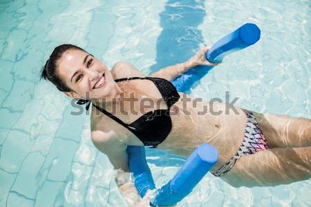 Gyönyörű nő bikini megnyugtató úszómedence víz szexi Stock fotó © wavebreak_media