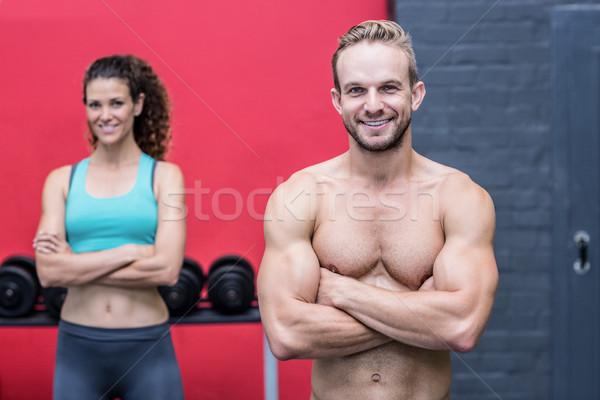 Muskuläre Paar schauen Kamera Mann vor Stock foto © wavebreak_media