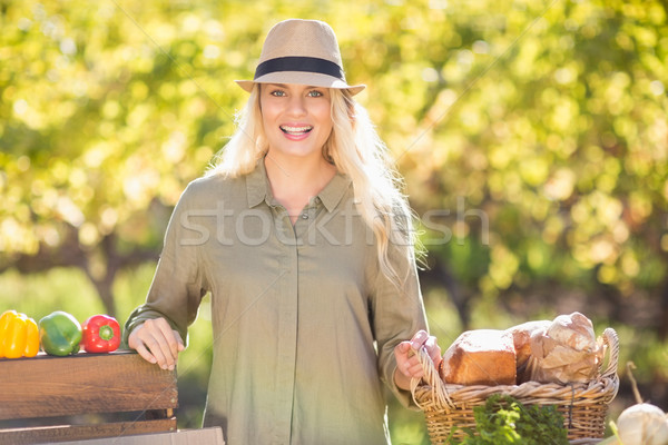 Blonde smiling over a table of organic food Stock photo © wavebreak_media