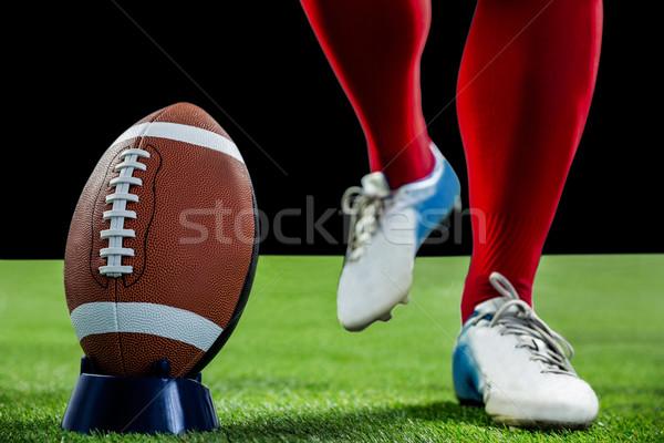 Amerikai futballista rúgás futball futballpálya fű Stock fotó © wavebreak_media