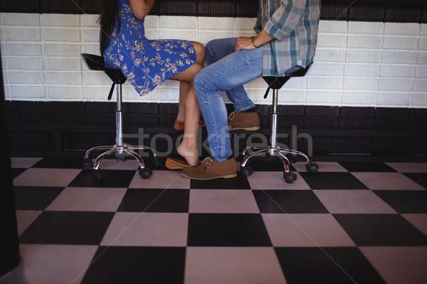 Low section of couple sitting on bar stool Stock photo © wavebreak_media