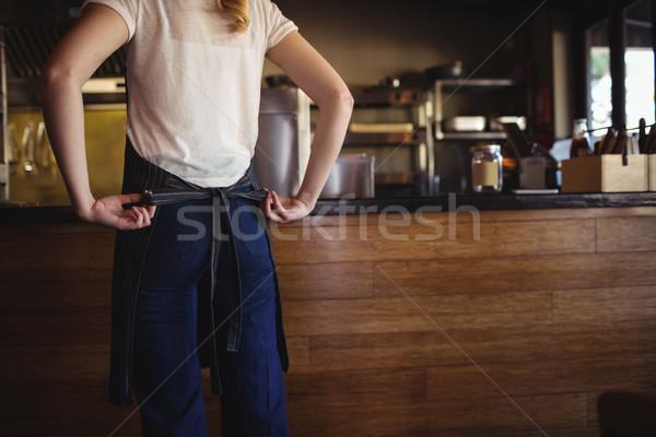 Waitress tying apron at restaurant Stock photo © wavebreak_media