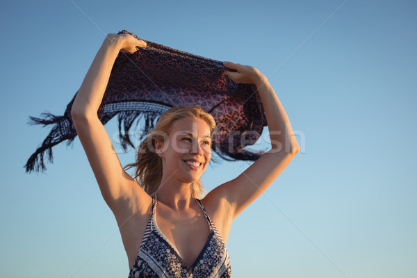 Happy woman holding scarf against clear sky Stock photo © wavebreak_media