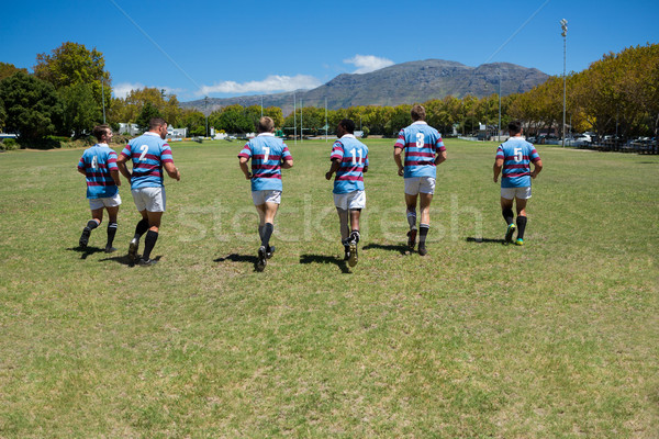 Rear view of rugby team running at field Stock photo © wavebreak_media
