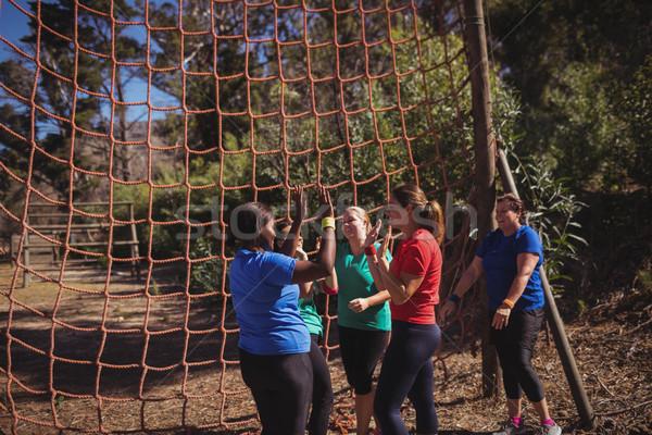 Grupy dopasować kobiet high five inny boot Zdjęcia stock © wavebreak_media