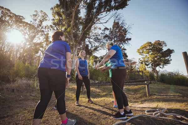 Group of fit women standing together in the boot camp Stock photo © wavebreak_media