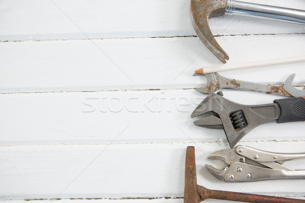Metallic hand tools on white wooden table Stock photo © wavebreak_media