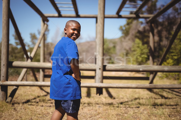 Portrait of happy boy standing with hands on hip during obstacle course Stock photo © wavebreak_media