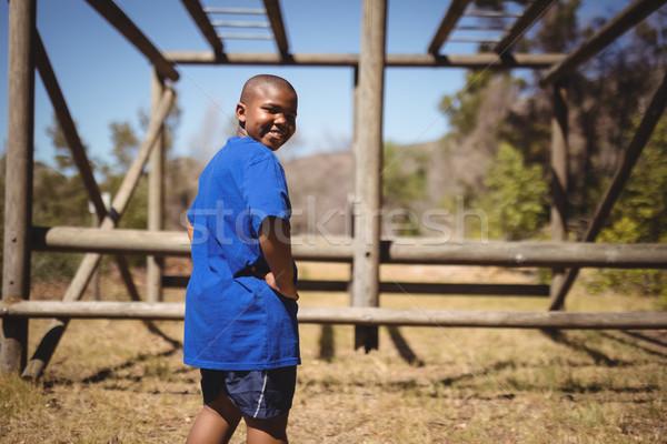 Portré vidám fiú áll kezek csípő akadályfutás Stock fotó © wavebreak_media