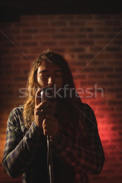 Erkek şarkıcı gece kulübü uzun saçlı adam Stok fotoğraf © wavebreak_media