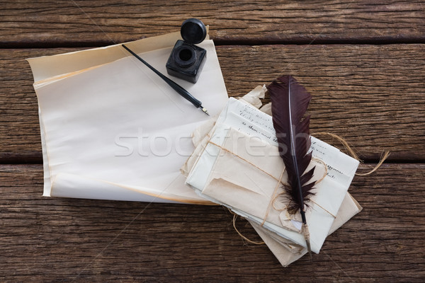 Quill feather, ink bottle, ink pen and legal documents on table Stock photo © wavebreak_media