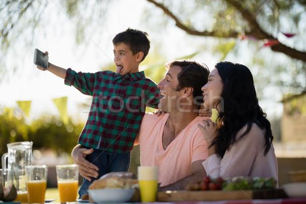 Family taking selfie on mobile phone in park Stock photo © wavebreak_media