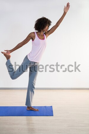 Side view of girl with arms raised exercising in room Stock photo © wavebreak_media