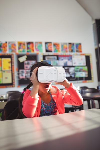 Surprised girl using virtual reality glasses in classroom Stock photo © wavebreak_media