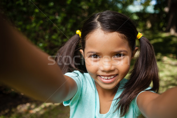 Close-up portrait of smiling girl with arms raised Stock photo © wavebreak_media