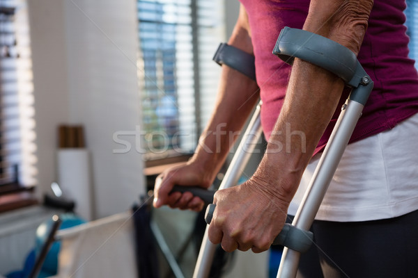 Mid-section of woman with crutches Stock photo © wavebreak_media
