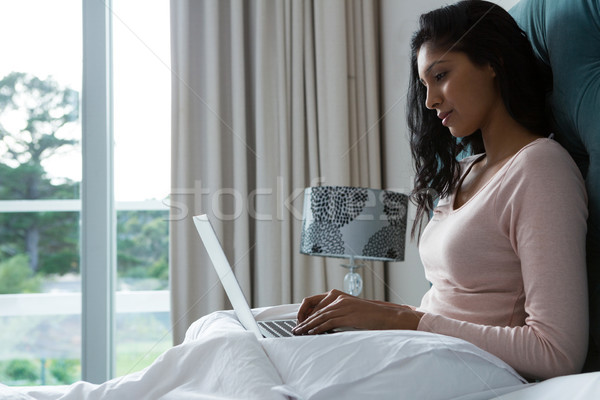 Young woman using laptop on bed Stock photo © wavebreak_media