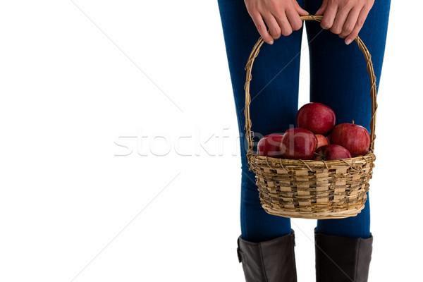 Középső rész nő tart almák fonott kosár Stock fotó © wavebreak_media